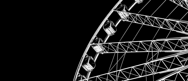 Black ferris wheel representing personal growth